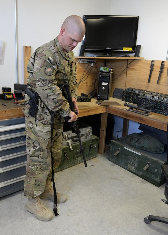 U.S. Air Force TSgt. Kevin Beers, 455th Expeditionary Security Forces Squadron combat arms instructor, conducts a function check on a M-4 rifle Aug. 10, 2015, at Bagram Airfield, Afghanistan. As Bagram's only weapons repairman, Beers is responsible for repairing weapons for the security forces squadron, logistics readiness squadron, Marines and all other units here. (U.S. Air Force photo by Senior Airman Cierra Presentado/Released)