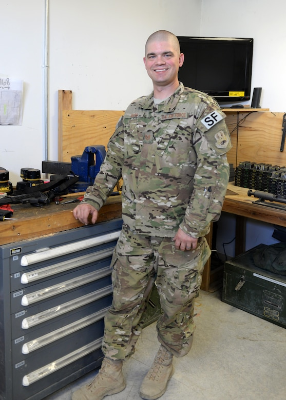 U.S. Air Force TSgt. Kevin Beers, 455th Expeditionary Security Forces Squadron combat arms instructor, poses for a photo Aug. 10, 2015, at Bagram Airfield, Afghanistan. As Bagram's only weapons repairman, Beers is responsible for repairing weapons for the security forces squadron, logistics readiness squadron, Marines and all other units here. (U.S. Air Force photo by Senior Airman Cierra Presentado/Released)