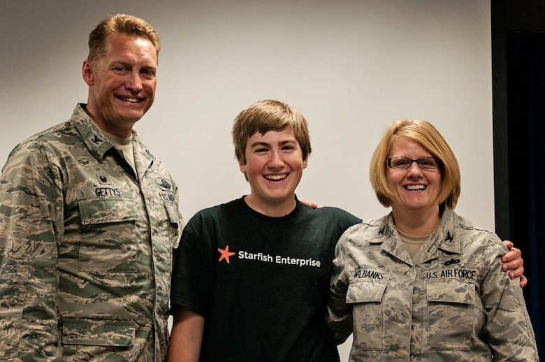 Col. Blake Gettys, commander of the 176th Wing, Alaska Air National Guard, poses for a photo with Brice Wilbanks and his mother, Col. Patty Wilbanks, commander of the 176th Mission Support Group, after being presented with a letter of thanks from Lt. Gen. Stanley Clarke III, director of the Air National Guard, at a ceremony on Joint Base Elmendorf-Richardson, Alaska, Aug. 14. Brice was presented the letter in recognition of being the recipient of the 2015 Air National Guard Youth of the Year award. (U.S. Air National Guard photo by Staff Sgt. Edward Eagerton/released)