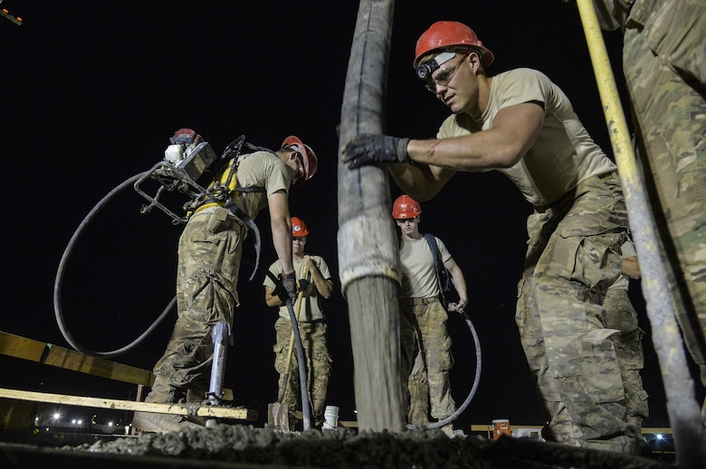 Senior Airman Anthony pours a concrete roof on a structure at an undisclosed location in Southwest Asia July 28, 2015. Airman Anthony is a structural apprentice assigned to the 557th Expeditionary RED HORSE Squadron. (U.S. Air Force photo/Tech. Sgt. Christopher Boitz)