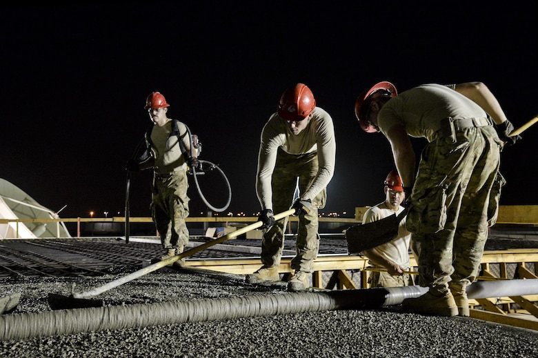 Airmen assigned to the 557th Expeditionary RED HORSE Squadron form the top of a concrete roof on a structure at an undisclosed location in Southwest Asia July 28, 2015. RED HORSE is a self-sustaining, mobile, heavy construction squadron capable of rapid response and independent operations in remote, high-threat environments worldwide. (U.S. Air Force photo/Tech. Sgt. Christopher Boitz)