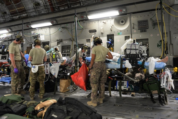 U.S. Airmen assigned to the 455th Expeditionary Aeromedical Evacuation Squadron provide in flight medical care to injured Service members on a C-17 Globemaster III aircraft that departed Bagram Airfield, Afghanistan, heading for medical care in Germany, Aug. 9, 2015.  The 455th EAES Airmen are charged with the responsibility of evacuating the sick and wounded from Central Command to higher echelons of medical care. (U.S. Air Force photo by Maj. Tony Wickman/Released)