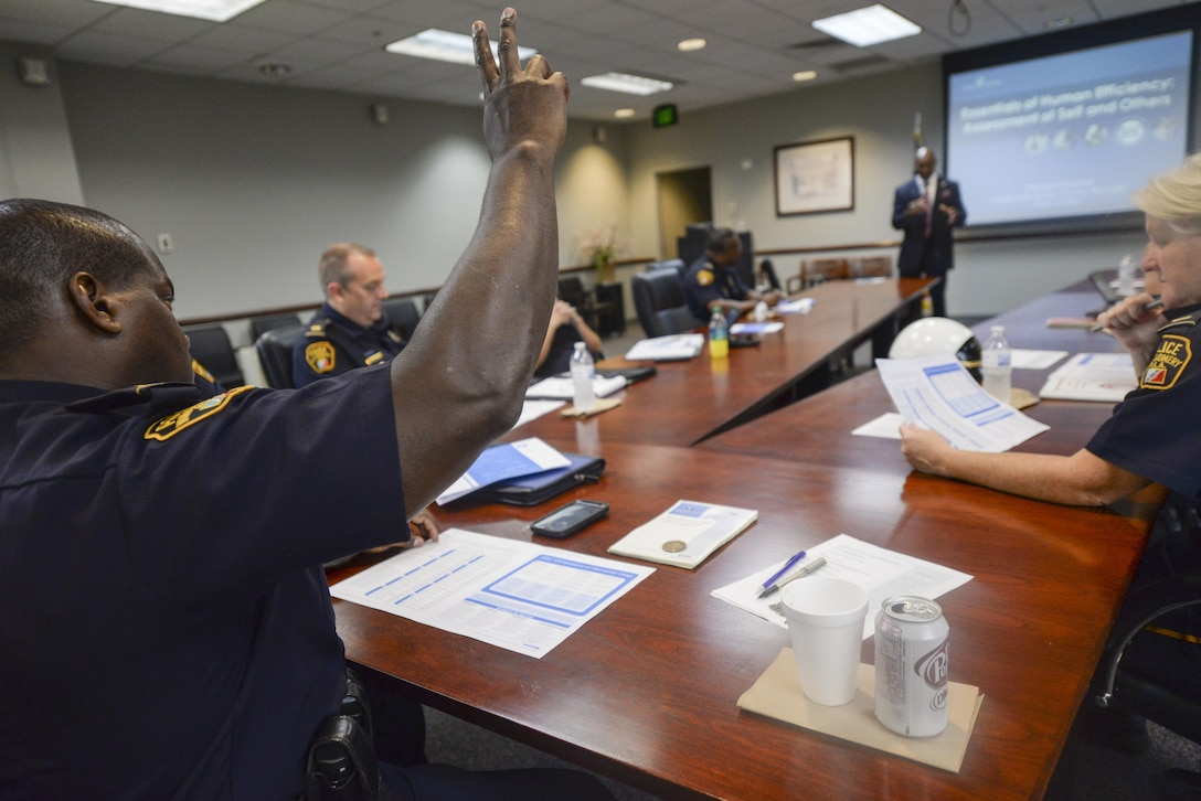Lt. Shon Wright, a 17-year veteran of the Montgomery Police Department, participates in a DiSC assessment class during a two-day leadership consortium at Officer Training School, Maxwell Air Force Base, Alabama, Aug. 6, 2015. The class covered four different leadership behavior traits – dominance, influence, steadiness and conscientiousness – and was designed to improve work productivity, teamwork, and communication skills. (U.S. Air Force photo by Tech. Sgt. Sarah Loicano)