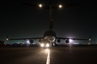 U.S. Airmen assigned to the 455th Expeditionary Aeromedical Evacuation Squadron and the 455th Expeditionary Medical Group load injured Service members onto a C-17 Globemaster III aircraft on the flight line at Bagram Airfield, Afghanistan, Aug. 8, 2015.  The 455th EAES Airmen are charged with the responsibility of evacuating the sick and wounded from Central Command to higher echelons of medical care. (U.S. Air Force photo by Tech. Sgt. Joseph Swafford/Released)