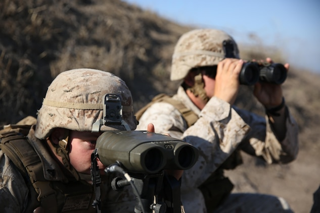 Corporal Brady Davenport (left), a fire support man, and 1st Lt. Mark Null (right), an artillery officer, both assigned to 2nd Battalion, 11th Marine Regiment, 1st Marine Divison, observe impacts from M777 Howitizers aboard Marine Corps Base Camp Pendleton, Calif., Aug. 14, 2015. 2/11 annually conducts Summer Fire Exercise to sustain core proficiencies and to further develop their ability to execute fire missions.