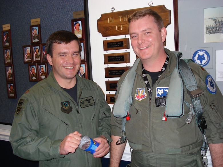 From left to right: Circa January 2008, then Majors William A. Allen and Stephen R. Allen, brothers and retired United States Air Force pilots, are pictured at McEntire Joint National Guard Base in Hopkins, South Carolina. Their mother, Martha Coley, an accountant in the Resource Management Division, supported their careers as a member of the Blue Star Mothers of America organization. BSMA's approximately 200 chapters across the United States join mothers, stepmothers, grandmothers and female legal guardians who gather in support of their children and the nation's troops.