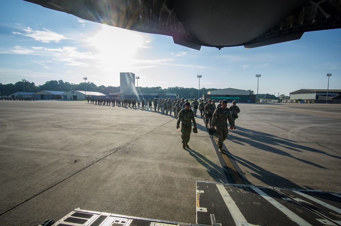 U.S. Army paratroopers walk toward the ramp of a C-17 Globemaster III Aug. 15, 2015 at Lawson Army Airfield, Fort Benning, Ga. Reserve aircrews from the 701st and 300th Airlift Squadron out of Joint Base Charleston, S.C. flew two C-17s during Fort Benning's celebration of the 75th anniversary of the U.S. Army Airborne School. Almost 300 paratroopers took the big leap in the day's event. (U.S. Air Force photo by Staff Sgt. Bobby Pilch)