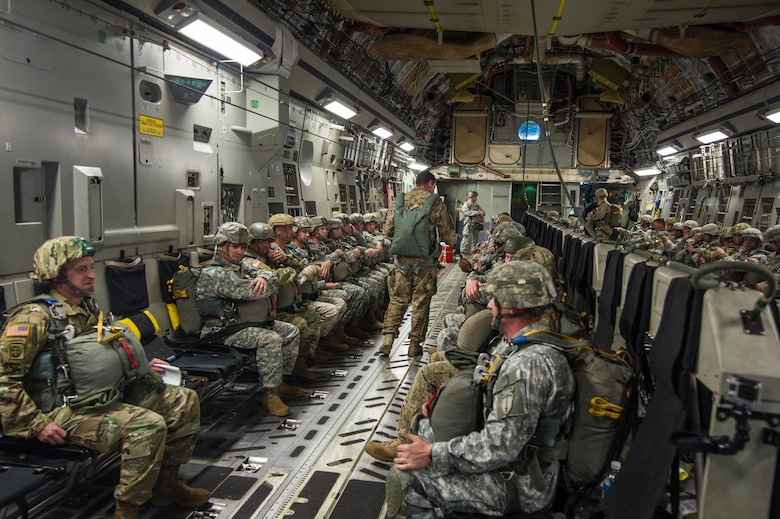 U.S. Army paratroopers being airlifted in a C-17 Globemaster III Aug. 15, 2015 over Lawson Army Airfield, Fort Benning, Ga. Reserve aircrews from the 701st and 300th Airlift Squadron out of Joint Base Charleston, S.C. flew two C-17s during Fort Benning's celebration of the 75th anniversary of the U.S. Army Airborne School. Almost 300 paratroopers took the big leap in the day's event. (U.S. Air Force photo by Staff Sgt. Bobby Pilch)