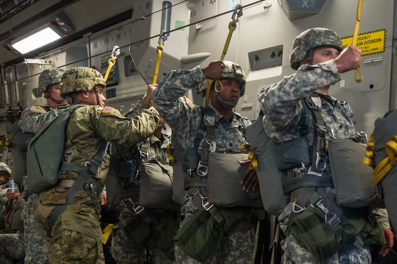U.S. Army paratroopers prepare to jump out of a C-17 Globemaster III Aug. 15, 2015 during a flight over Lawson Army Airfield, Fort Benning, Ga. Reserve aircrews from the 701st and 300th Airlift Squadron out of Joint Base Charleston, S.C. flew two C-17s during Fort Benning's celebration of the 75th anniversary of the U.S. Army Airborne School. Almost 300 paratroopers took the big leap in the day's event. (U.S. Air Force photo by Staff Sgt. Bobby Pilch)