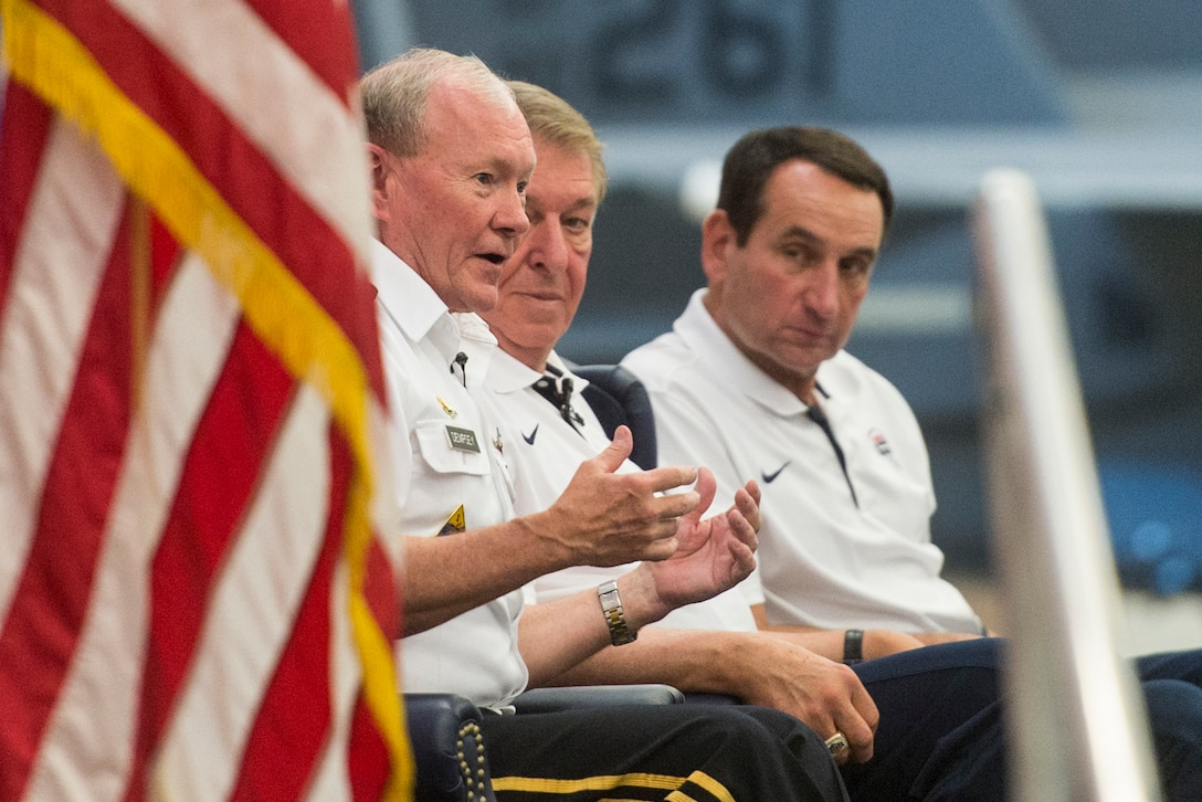 Army Gen. Martin E. Dempsey, chairman of the Joint Chiefs of Staff; Jerry Colangelo, the USA Basketball chairman and managing director; and Mike Krzyzewski, Duke University basketball Coach, hold a leadership panel discussion with Airmen at Nellis Air Force Base, Nev., Aug. 13, 2015. (DoD News photo)