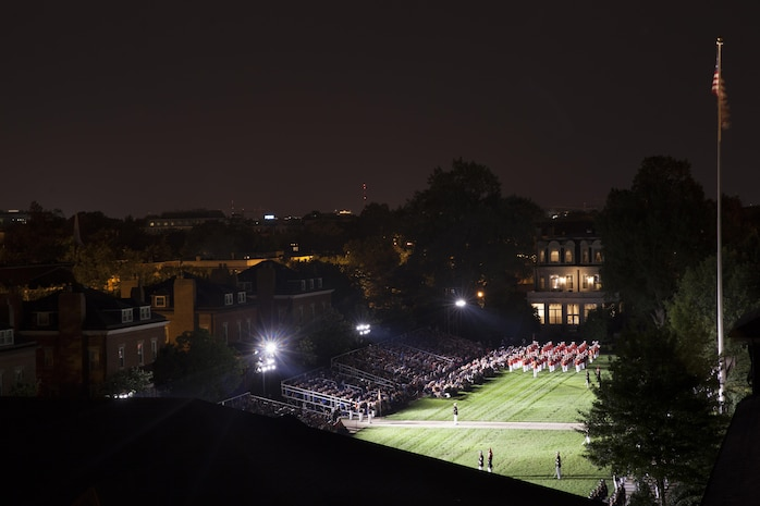 Marines with Marine Barracks Washington, D.C., perform during an evening parade, Aug. 14, 2015. Lance Cpl. Joshua Leakey, recipient of the Victoria Cross, the highest military decoration for valor in the British and Commonwealth armed forces, and Lt. Gen. Jon M. Davis, deputy commandant for Aviation, was the hosting official for that same parade. The Evening Parade began in 1934 and features the Silent Drill Platoon, the U.S. Marine Band, the U.S. Marine Corps Drum and Bugle Corps, and two marching companies. More than 3500 guests attend the parade every week. (U.S. Marine Corps photo by Lance Cpl. Christopher J. Nunn/Released)
