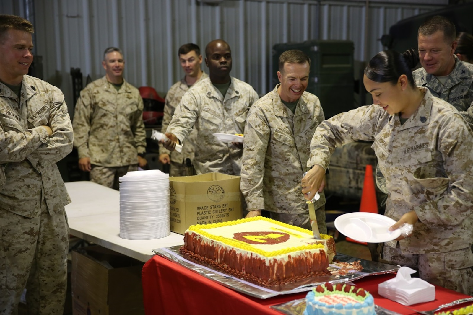 Col. Jay M. Bargeron and Marines with Special Purpose Marine Air Ground Task Force-Crisis Response-Central Command celebrate the 7th Marine Regiment's 98th anniversary after a ceremony, held in an undisclosed location in Southwest Asia, Aug. 15, 2015. The 7th Marine Regiment Headquarters and 3rd Battalion, 7th Marines are currently deployed with the SPMAGTF-CR-CC and took time to remember the regiment's storied history and rededicate themselves to their current work with Operation Inherent Resolve.