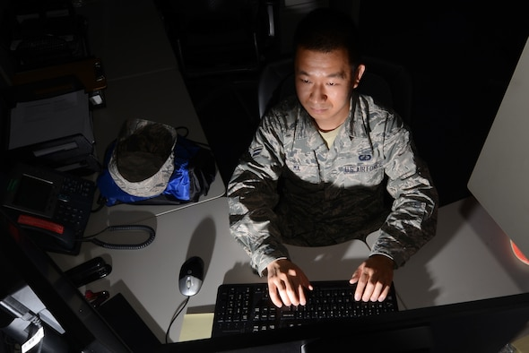 Airman 1st Class Bin Ma, a 20th Comptroller Squadron financial services technician, works after hours reviewing finances for Airmen at Shaw Air Force Base, S.C., July 31, 2015. Ma is applying to commission in the Medical Service Corps for a position in hospital administration which is in charge of resources, personnel and money, to keep clinics running. (U.S. Air Force photo/Senior Airman Michael Cossaboom)