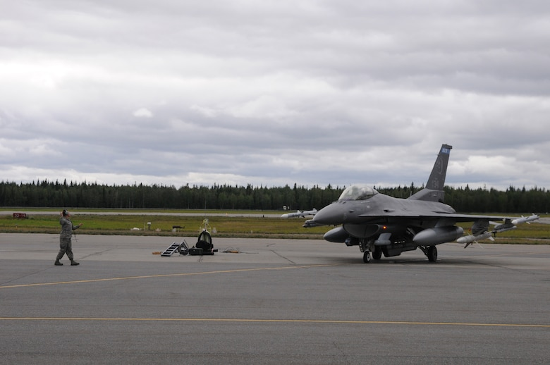 U.S. Air Force Staff Sgt. Chelsea Lien, a 148th Fighter Wing crew chief, Duluth, Minn., goes through pre-flight checks with an F-16 pilot, Aug. 10, 2015, while participating in RED FLAG-Alaska 15-3 at Eielson Air Force Base, Alaska.  RF-A is a Pacific Air Forces commander-directed field training exercise for U.S. and partner nation forces, providing combined offensive counter-air, interdiction, close air support and large force employment training in a simulated combat environment.  (U.S. Air Force photo by Master Sgt. Ralph Kapustka/Released)