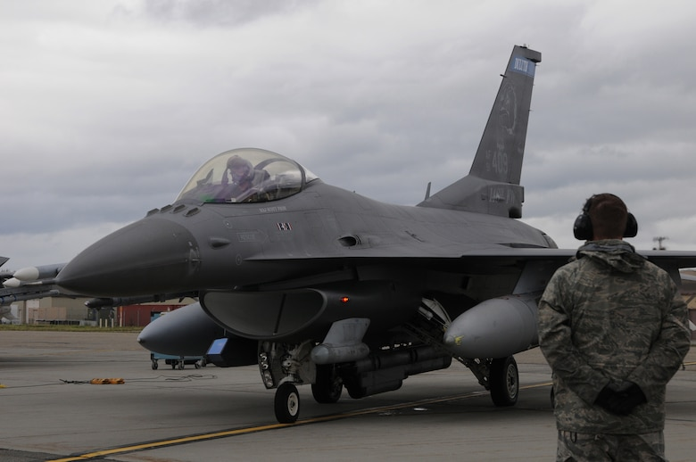 A U.S. Air Force crew chief with the 148th Fighter Wing, Duluth, Minn., goes through pre-flight checks with an F-16 pilot Aug. 10, 2015, while participating in RED FLAG-Alaska 15-3 at Eielson Air Force Base, Alaska.  RF-A is a Pacific Air Forces commander-directed field training exercise for U.S. and partner nation forces, providing combined offensive counter-air, interdiction, close air support and large force employment training in a simulated combat environment.  (U.S. Air Force photo by Master Sgt. Ralph Kapustka/Released)