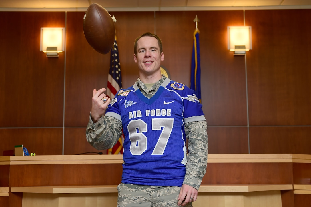 Capt. Tyler Weeks, 460th Space Wing Judge Advocate intern, wears his Air Force Academy Falcons jersey Aug. 12, 2015, on Buckley Air Force Base, Colo. Weeks played offensive line for the Falcons during his four years at the Academy. He is pursuing a law degree from the University of Colorado Law School and interned in the legal office this summer. (U.S. Air Force photo by Airman 1st Class Luke W. Nowakowski/Released)