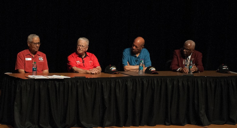 From left to right, retired Col. Charles McGee and Lt. Cols. George Hardy, Harry Stewart and James Harvey III, four of the original Tuskegee Airmen, respond to a question about their military career during a presentation at the Cheyenne Civic Center, Cheyenne, Wyo., August 14, 2015. Out of the 354 Tuskegee pilots who flew in combat missions during World War II, only 21 remain. (U.S. Air Force photo by Airman 1st Class Brandon Valle)