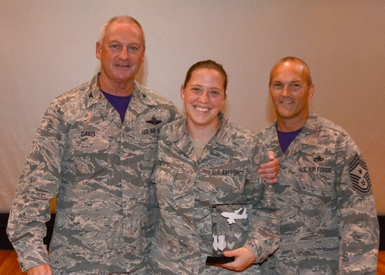 Senior Airman Natalee D. Gates, 507th Air Refueling Wing Command Post, accepts her award for Airman of the Quarter for the second quarter 2015 in the base theater at Tinker Air Force Base, Okla., August 9, 2015. (U.S. Air Force Photo/ Staff Sgt. Lauren Gleason)