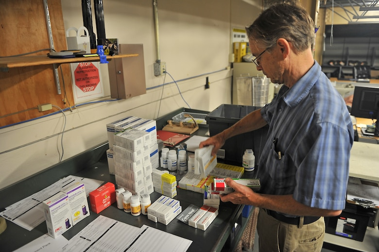 ALTUS AIR FORCE BASE, Okla. – Steve Redeker, 97th Medical Group warehouse material manager, accounts for medical supplies inside the medical group warehouse, Aug. 13, 2015. Redeker ensures the items are not about to expire and that they received their entire order. (U.S. Air Force photo by Senior Airman Dillon Davis/Released)