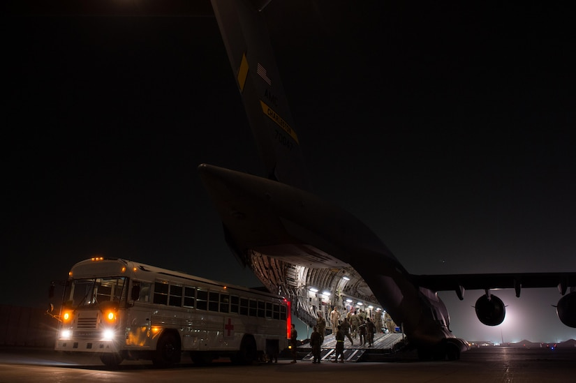 U.S. Air Force Airmen assigned to the 455th Expeditionary Aeromedical Evacuation Squadron and the 455th Expeditionary Medical Group load injured service members onto a C-17 Globemaster III aircraft at Bagram Airfield, Afghanistan, Aug. 8, 2015. (U.S. Air Force photo by Tech. Sgt. Joseph Swafford)