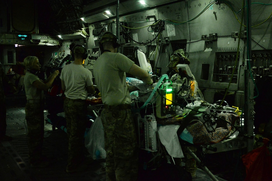 U.S. Air Force Airmen assigned to the 455th Expeditionary Aeromedical Evacuation Squadron provide in-flight medical care to injured service members on a C-17 Globemaster III that departed Bagram Airfield, Afghanistan, heading for medical care in Germany, Aug. 9, 2015. (U.S. Air Force photo by Maj. Tony Wickman)