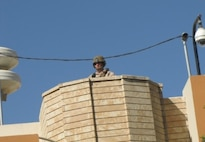 An MSAU Marine stands guard at U.S. Consulate Erbil during a heightened security situation, September 11, 2014.