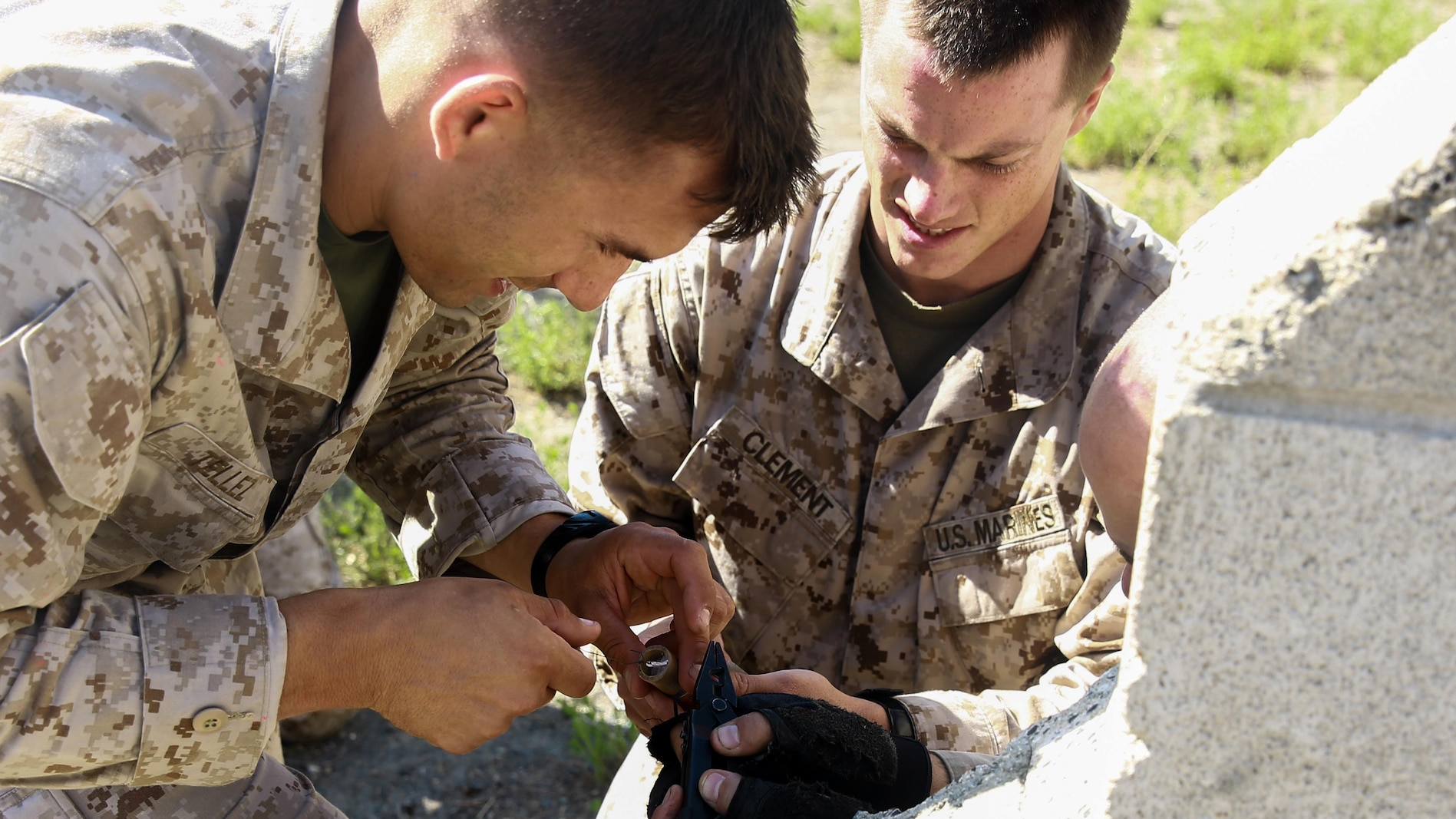 Marines with 1st Battalion, 7th Marine Regiment, and 2nd Battalion, 7th Marine Regiment, set a simulated booby trap to alert nearby Marines when an enemy is attempting to infiltrate their position during the culminating event of 1st Marine Division Schools' Urban Leaders Course at Marine Corps Base Camp Pendleton, Calif., Aug. 12, 2015. The course is a 15-day period of instruction that includes classwork, combat marksmanship and physical training executed in a simulated urban combat environment.