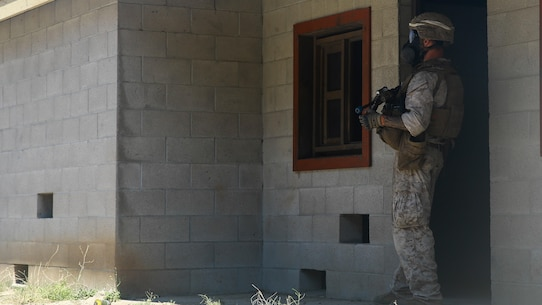 A Marine with 2nd Battalion, 7th Marine Regiment, provides security during the culminating event of 1st Marine Division Schools' Urban Leaders Course at Marine Corps Base Camp Pendleton, Calif., Aug. 12, 2015. The course is a 15-day period of instruction that includes classwork, combat marksmanship and physical training executed in a simulated urban combat environment.