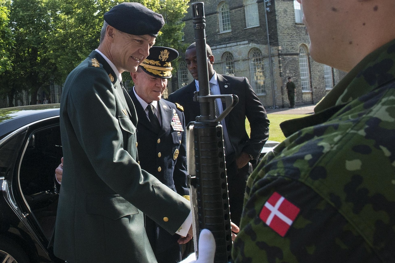 Danish Chief of Defense Army Gen. Peter Bartram greets U.S. Army Gen. Martin E. Dempsey, second from left, chairman of the Joint Chiefs of Staff, at the Defense command headquarters in Copenhagen, Denmark, Aug. 17, 2015. DoD photo by D. Myles Cullen