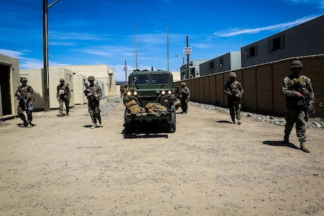 Marines with Company B, 1st Battalion, 1st Marine Regiment, escort an M1161 Internally Transportable Vehicle through a simulated combat town during the first phase of a Limited Objective Experiment aboard Marine Corps Base Camp Pendleton, Calif., Aug. 13, 2015. The experiment is comprised of the integration of ITVs with infantry units to provide the Marine Corps Warfighting Laboratory with an understanding of how the vehicles will be added to the battalions. The second part of the experiment will take place at Fort Hunter Liggett, Calif., which will provide the Marines with extensive amounts of terrain to test the vehicles' capabilities over a 3-week training period. (U.S. Marine Corps Photo by Sgt. Rick Hurtado / Released)