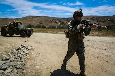 Sergeant Edwin Orozco, a native of San Bernardino, Calif., and a platoon sergeant with Company B, 1st Battalion, 1st Marine Regiment, escorts an M1161 Internally Transportable Vehicle during the first phase of a Limited Objective Experiment aboard Marine Corps Base Camp Pendleton, Calif., Aug. 13, 2015. The experiment is comprised of the integration of ITVs with infantry units to provide the Marine Corps Warfighting Laboratory with an understanding of how the vehicles will be added to the battalions. The second part of the experiment will take place at Fort Hunter Liggett, Calif., which will provide the Marines with extensive amounts of terrain to test the vehicles' capabilities over a 3-week training period. (U.S. Marine Corps Photo by Sgt. Rick Hurtado / Released)