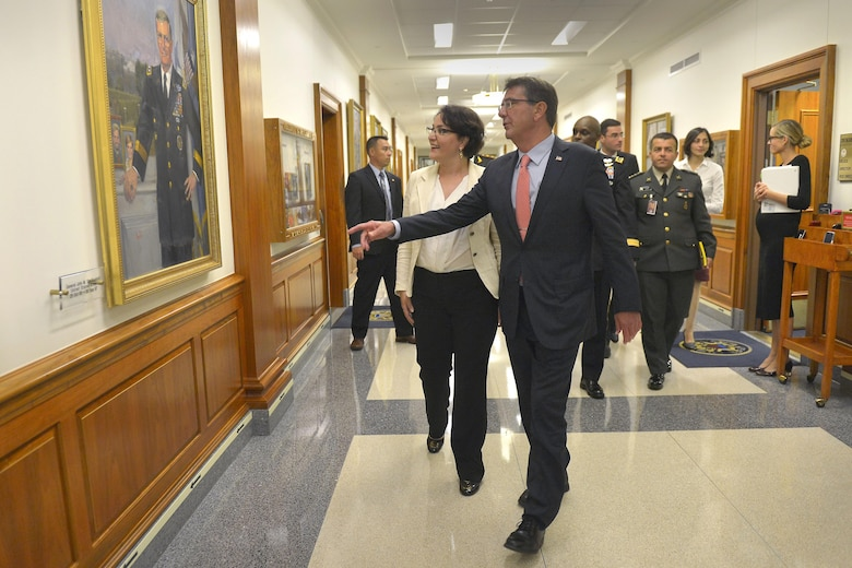 U.S. Defense Secretary Ash Carter welcomes Georgian Defense Minister Tinatin Khidasheli to the Pentagon, Aug. 18, 2015, while showing her the portrait of U.S. Army Gen. John M. Shalikashvili, former chairman of the Joint Chiefs of Staff. Born in Warsaw, Poland, to Georgian parents, Shalikashvili served as the chairman from 1993 to 1997. The two defense leaders met to discuss matters of mutual importance. DoD photo by Glenn Fawcett