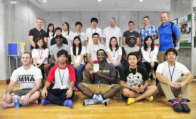 Kadena Language Institute students pose with volunteers from the 18th Wing for a group photo after a culture exchange at Kadena Rotary Plaza, Japan, Aug. 14, 2015. Ten volunteers participated with the institute to clean the neighborhood as part of a community relations event while also conversing with KLI students in English. (U.S. Air Force photo by Naoto Anazawa/Released)
