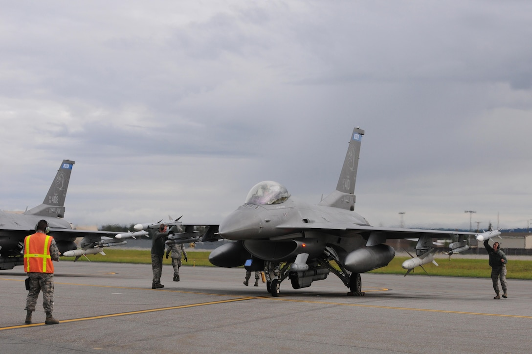U.S. Air Force weapons load Airmen from the 148th Fighter Wing, Duluth, Minnesota, perform final inspections before take-off on a F-16 Fighting Falcon at Eielson Air Force Base, Alaska, Aug. 11, 2015, during RED FLAG-Alaska 15-3.  RF-A is a Pacific Air Forces commander-directed field training exercise for U.S. and partner nation forces, providing combined offensive counter-air, interdiction, close air support and large force employment training in a simulated combat environment.  (U.S. Air Force photo by Master Sgt. Ralph Kapustka/Released)