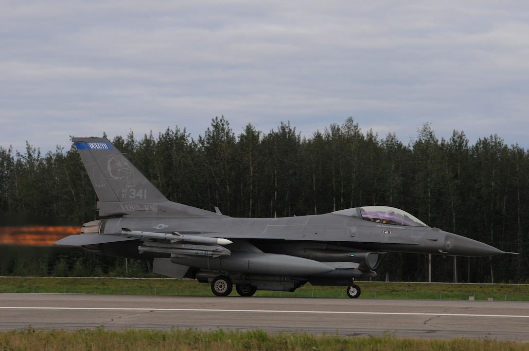 A U.S. Air Force F-16 Fighting Falcon from the 148th Fighter Wing, Duluth, Minnesota, takes-off at Eielson Air Force Base, Alaska, Aug. 11, 2015, during RED FLAG-Alaska 15-3.  RF-A is a Pacific Air Forces commander-directed field training exercise for U.S. and partner nation forces, providing combined offensive counter-air, interdiction, close air support and large force employment training in a simulated combat environment.  (U.S. Air Force photo by Master Sgt. Ralph Kapustka/Released)