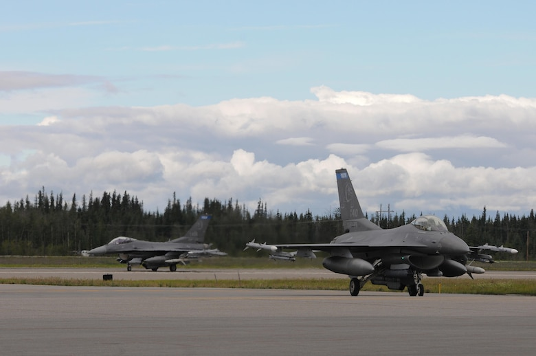 U.S. Air Force F-16 Fighting Falcons from the 148th Fighter Wing, Duluth, Minnesota, taxi on to the ramp at Eielson Air Force Base, Alaska, Aug. 11, 2015, during RED FLAG-Alaska 15-3. RF-A is a Pacific Air Forces commander-directed field training exercise for U.S. and partner nation forces, providing combined offensive counter-air, interdiction, close air support and large force employment training in a simulated combat environment.  (U.S. Air Force photo by Master Sgt. Ralph Kapustka/Released)