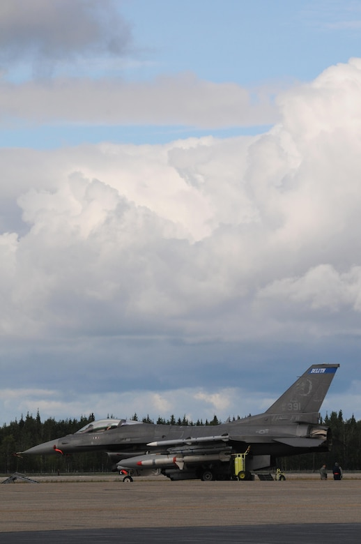 A U.S. Air Force F-16 Fighting Falcon from the 148th Fighter Wing, Duluth, Minnesota, is parked on the ramp at Eielson Air Force Base, Alaska, Aug 11, 2015, during RED FLAG-Alaska 15-3. RF-A is a Pacific Air Forces commander-directed field training exercise for U.S. and partner nation forces, providing combined offensive counter-air, interdiction, close air support and large force employment training in a simulated combat environment.  (U.S. Air Force photo by Master Sgt. Ralph Kapustka/Released)