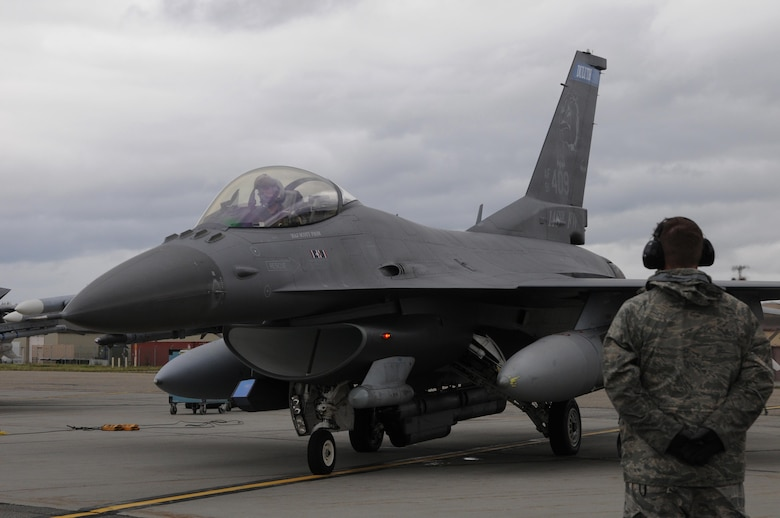 A U.S. Air Force crew chief with the 148th Fighter Wing, Duluth, Minnesota, goes through pre-flight checks with an F-16 pilot Aug. 10, 2015, while participating in RED FLAG-Alaska 15-3 at Eielson Air Force Base, Alaska. RF-A is a Pacific Air Forces commander-directed field training exercise for U.S. and partner nation forces, providing combined offensive counter-air, interdiction, close air support and large force employment training in a simulated combat environment.  (U.S. Air Force photo by Master Sgt. Ralph Kapustka/Released)
