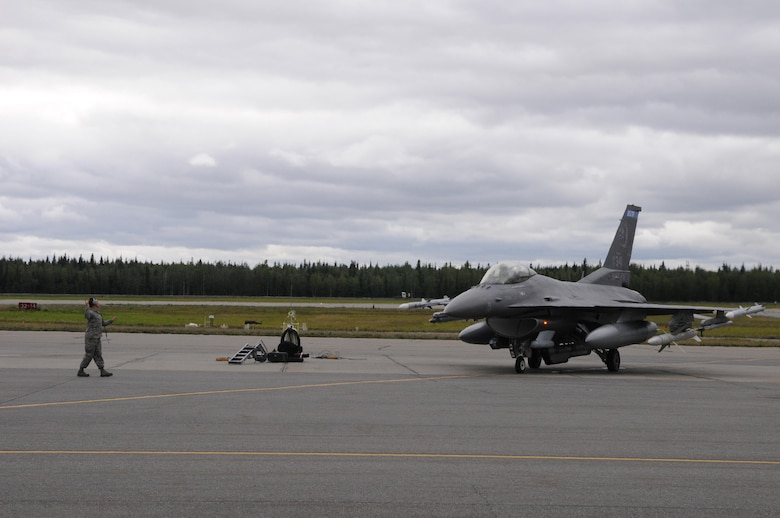 U.S. Air Force Staff Sgt. Chelsea Lien, a 148th Fighter Wing crew chief, Duluth, Minnesota, goes through pre-flight checks with an F-16 pilot, Aug. 10, 2015, while participating in RED FLAG-Alaska 15-3 at Eielson Air Force Base, Alaska. RF-A is a Pacific Air Forces commander-directed field training exercise for U.S. and partner nation forces, providing combined offensive counter-air, interdiction, close air support and large force employment training in a simulated combat environment.  (U.S. Air Force photo by Master Sgt. Ralph Kapustka/Released)