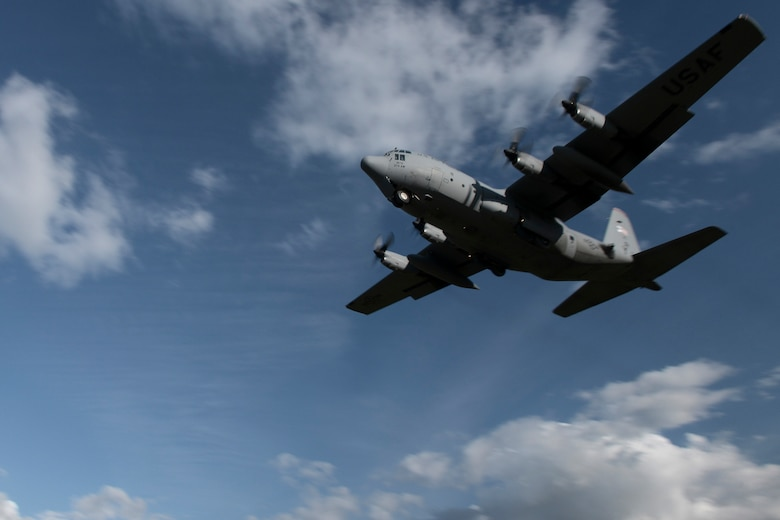 A U.S. Air Force C-130 Hercules with the 36th Airlift Squadron from Yokota Air Base, Japan, takes off of an austere runway used for training during RED FLAG-Alaska at Joint Base Elmendorf-Richardson, Alaska, Aug. 14, 2015. The training allowed C-130 aircrew to practice austere landings and take offs, combat offloads and supply drops, but also allowed friendly competition between participating Air Forces: U.S. Air Force, Japan Air Self-Defense Force, Royal Air Force, Royal Australian Air Force, Royal New Zealand Air Force and Royal Thai Air Force. Seasoned C-130 aircrew from each country judged the training exercises from the ground, allotting points based off predetermined timing and accuracy requirements. (U.S. Air Force photo by Staff Sgt. Cody H. Ramirez/Released)