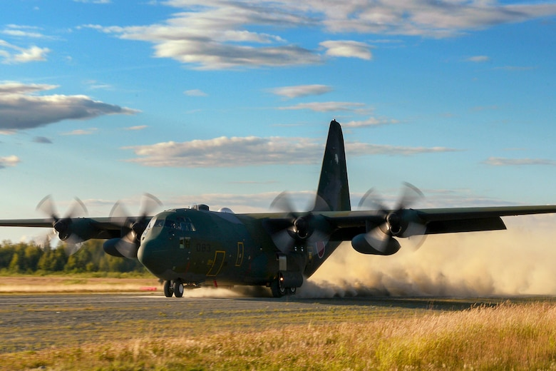 A C-130 Hercules with the Japanese Air Self-Defense Force lands on an austere runway used for training during RED FLAG-Alaska at Joint Base Elmendorf-Richardson, Alaska, Aug. 14, 2015. The training allowed C-130 aircrew to practice austere landings and take offs, combat offloads and supply drops, but also allowed friendly competition between participating Air Forces: U.S. Air Force, Japan Air Self-Defense Force, Royal Air Force, Royal Australian Air Force, Royal New Zealand Air Force and Royal Thai Air Force. Seasoned C-130 aircrew from each country judged the training exercises from the ground, allotting points based off predetermined timing and accuracy requirements. (U.S. Air Force photo by Staff Sgt. Cody H. Ramirez/Released)