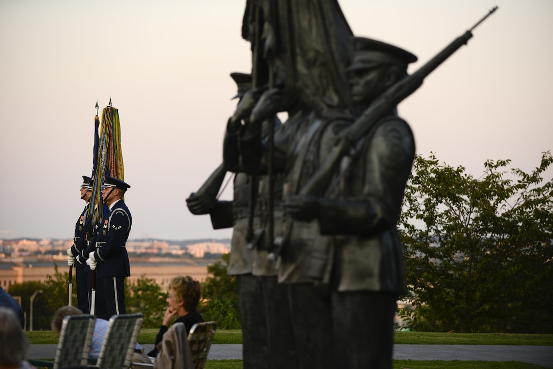 Members of the Air Force Honor Guard standby to present the colors during a wreath-laying ceremony, a four-ship P-51 Mustang flyover and the Air Force Band concert commemorating the 70th anniversary of the end of World War II, Aug. 14, 2015 at the Air Force Memorial in Arlington, Virginia. (Air Force photo/Tech. Sgt. Joshua L. DeMotts)