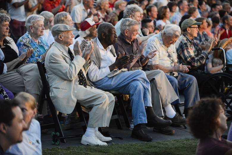World War II veterans (from left) retired Brig. Gen. James 'J. Richard' Compton, retired Army Lt. CJ Moore, retired Army Sgt. Ron Locke, retired Marine Corps Sgt. Charley Schuck and retired Navy Capt. John Reed applaud a performance by the Air Force Band at the Air Force Memorial in Arlington, Va., Aug. 14, 2015.  The event included a wreath-laying ceremony and a four-ship P-51 Mustang flyover to commemorate the 70th anniversary of the end of World War II.  (Air Force photo/Tech. Sgt. Joshua L. DeMotts)