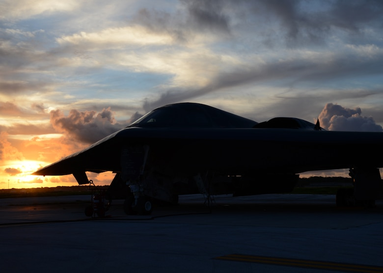 A U.S. Air Force B-2 Spirit is prepared for a mission on the flightline at Andersen Air Force Base, Guam, Aug. 12, 2015. Three B-2s and about 225 Airmen from Whiteman Air Force Base, Missouri, deployed to Guam to conduct familiarization training activities in the Indo-Asia-Pacific region. (U.S. Air Force photo by Senior Airman Joseph A. Pagán Jr./Released)