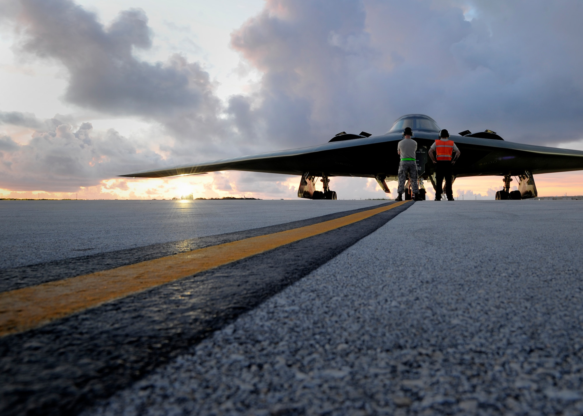 Crew chiefs assigned to the 509th Aircraft Maintenance Squadron prepare to launch a U.S. Air Force B-2 Spirit at Andersen Air Force Base, Guam, Aug. 12, 2015.  Three B-2s and about 225 Airmen from Whiteman Air Force Base, Missouri, deployed to Guam to conduct familiarization training activities in the Indo-Asia-Pacific region. (U.S. Air Force photo by Senior Airman Joseph A. Pagán Jr./Released)