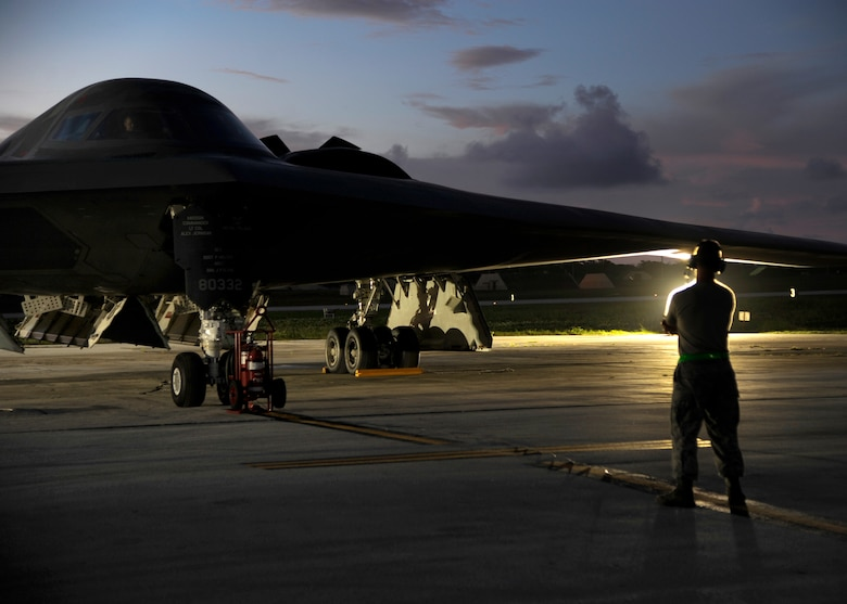 An aircraft maintainer with the 509th Aircraft Maintenance Squadron assists with the launch of a U.S. Air Force B-2 Spirit at Andersen Air Force Base, Guam, Aug. 12, 2015. Three B-2s and about 225 Airmen from Whiteman Air Force Base, Missouri, deployed to Guam to conduct familiarization training activities in the Indo-Asia-Pacific region. (U.S. Air Force photo by Senior Airman Joseph A. Pagán Jr./Released)