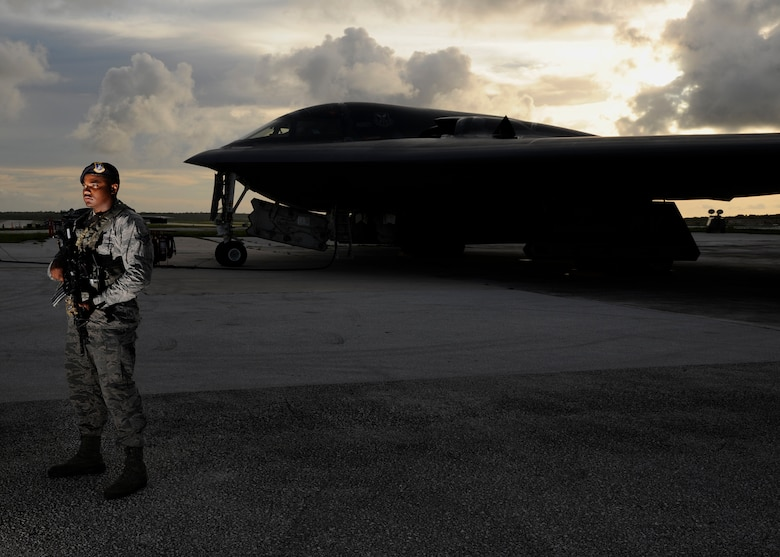 U.S. Air Force Senior Airman Jeico Sanchez-Arias, 509th Security Forces Squadron security journeyman, guards a U.S. Air Force B-2 Spirit on the flightline at Andersen Air Force Base, Guam, Aug. 12, 2015. Airmen and B-2 Spirits from the 13th Bomb Squadron at Whiteman Air Force Base, Missouri, are deployed to Guam to conduct familiarization training activities in the Pacific (U.S. Air Force photo by Senior Airman Joseph A. Pagán Jr./Released)
