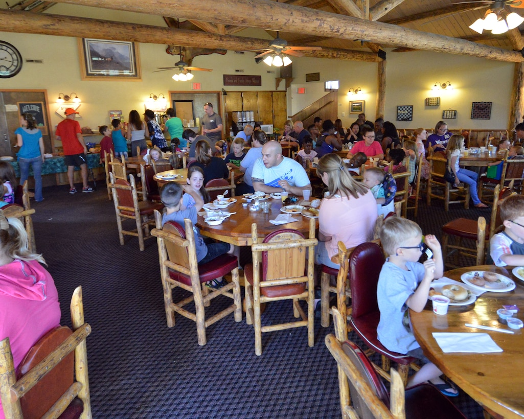 Participants from the 50th Space Wing Chapel-sponsored family retreat eat breakfast Sunday, Aug.16, 2015, at the Horn Creek Christian Camp and Conference Grounds in Westcliffe, Colorado. The retreat, which was held Aug. 14 – 16, gave 20 families from Schriever Air Force Base, Colorado the opportunity to disconnect from their electronic devices and reconnect with each other. (U.S. Air Force photo/Staff Sgt. Debbie Lockhart)