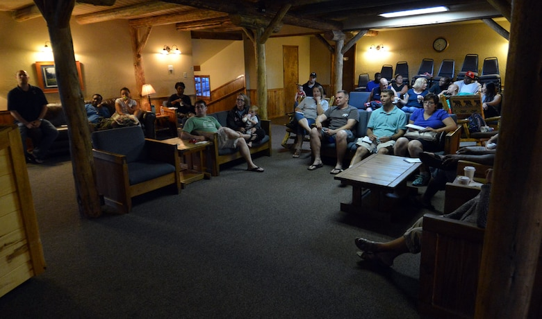 Participants from the 50th Space Wing Chapel-sponsored family retreat discuss family resiliency Saturday, Aug. 15, 2015, at the Horn Creek Christian Camp and Conference Grounds in Westcliffe, Colorado. The retreat promoted family bonding, goal setting and resiliency through various activities to include a resiliency session, family movie night, bonfire and access to a recreation center. (U.S. Air Force photo/Staff Sgt. Debbie Lockhart)