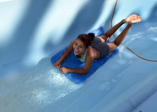 Tiana Williams slides down a water slide during a 50th Space Wing Chapel-sponsored family retreat Saturday, Aug. 15, 2015, at the Horn Creek Christian Camp and Conference Grounds in Westcliffe, Colorado. The retreat was held Aug. 14 – 16 and gave 20 Schriever Air Force Base families the opportunity to disconnect from their electronic devices and reconnect with each other. (U.S. Air Force photo/Staff Sgt. Debbie Lockhart)